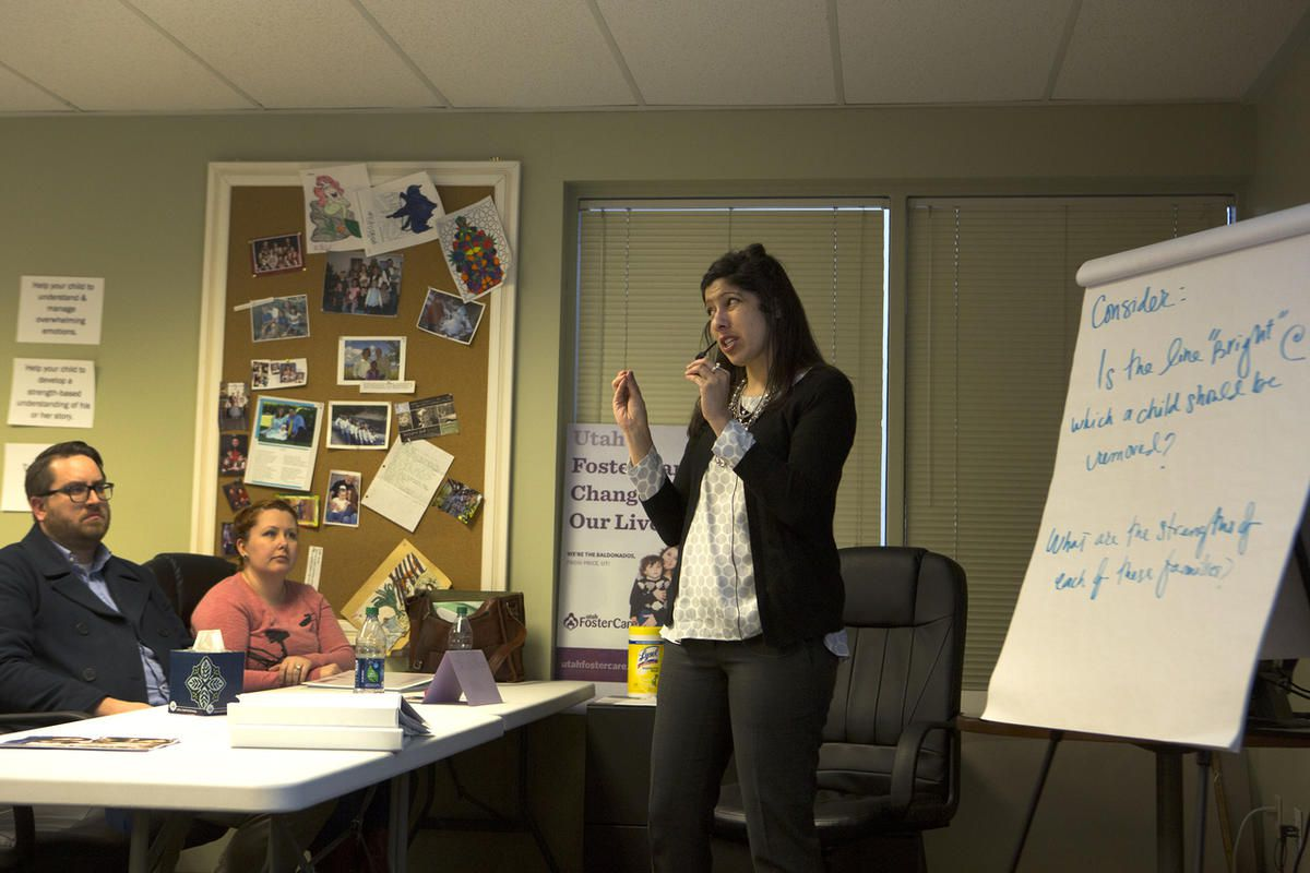 Utah Foster Care trainer Liz Rivera teaches during one of the eight, four-hour long classes required to train and educate potential foster parents Wednesday, Jan. 10, 2016 at the Utah Foster Care Foundation in Murray.