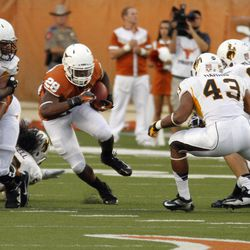 Texas running back Malcolm Brown runs for yardage during the first quarter of  an NCAA college football game against Wyoming, Saturday, Sept. 1, 2012, in Austin, Texas.