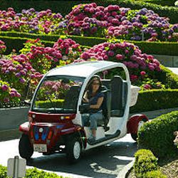 Vanessa Holland drives the Global Electric Motorcar down Lombard Street, the crookedest street in San Francisco. The cart offers a fresh way to tour landmarks.