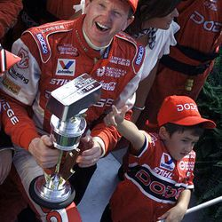 Chase Elliott, right, son of Brickyard 400 champion Bill Elliott, celebrates with his father after winning the ninth running of the Brickyard 400 at the Indianapolis Motor Speedway on Aug. 4, 2002. Call it the family business, genes or just fate. Chase Elliott, now 13, has dreamed of racing in NASCAR since he ran his Matchbox car go in circles.