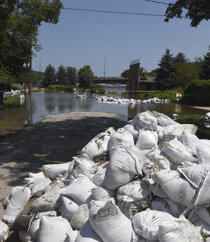 Sandbags are ready to be deployed on La Fox River Drive in Algonquin, on Thursday, where residents are bracing for another round of heavy rains that could raise the swollen Fox River even higher Friday night and Saturday morning. | Rick West/Daily Herald
