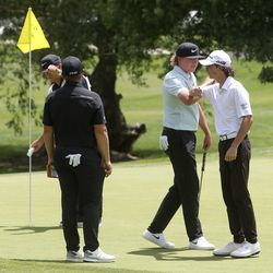 Cole Ponich, right, bumps elbows with Preston Summerhays after finishing the first round of the Utah Championship golf tournament on the Korn Ferry Tour at Oakridge Country Club in Farmington on Thursday, June 25, 2020. Danial Summerhays, left, rounded out the threesome during the first round.