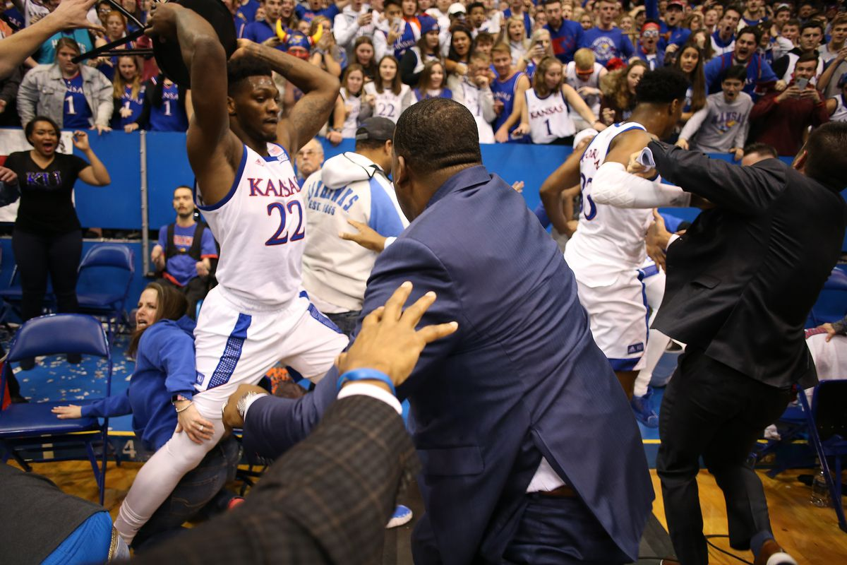 Silvio De Sousa of the Kansas Jayhawks picks up a chair during a brawl as the game against the Kansas State Wildcats ends at Allen Fieldhouse on January 21, 2020 in Lawrence, Kansas.