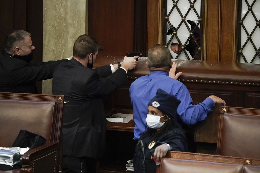 Lawmakers crouched under desks and donned gas masks while police futilely tried to barricade the U.S. Capitol on Wednesday.