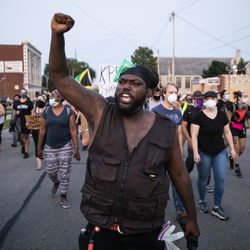 Protesters peacefully march around Kenosha on the fourth day of civil unrest after police shot Jacob Blake, Wednesday night, Aug. 26, 2020.