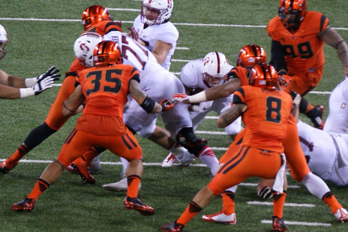 Oregon State linebackers Caleb Saulo, l. 35, and Rommel Mangeo, r, 8, have been solid anchors for the Beaver defense this season.