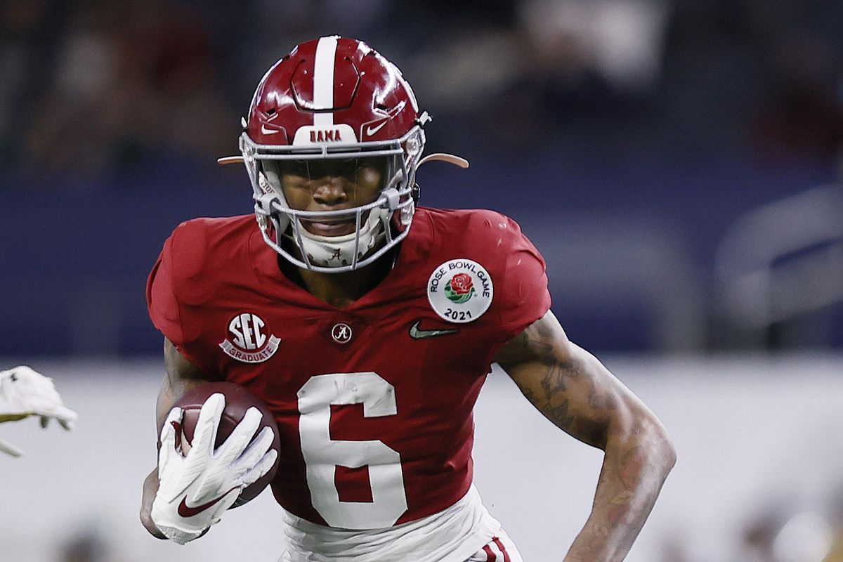 Wide receiver DeVonta Smith of the Alabama Crimson Tide rushes for a touchdown over the defense of Notre Dame Fighting Irish during the second quarter of the 2021 College Football Playoff Semifinal Game at the Rose Bowl Game presented by Capital One at AT&T Stadium on January 01, 2021 in Arlington, Texas.