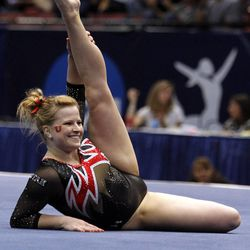 Utah's Tory Wilson competes in the floor exercise during the NCAA college women's gymnastics championships on Friday, April 18, 2014, in Birmingham, Ala. (AP Photo/Butch Dill)