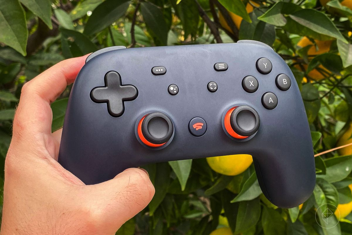 Google Stadia controller being held