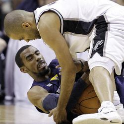 Memphis Grizzlies' Mike Conley, bottom, and San Antonio Spurs' Tony Parker, top, of France, scramble for control of the ball during the first quarter of an NBA basketball game on Thursday, April 12, 2012, in San Antonio.