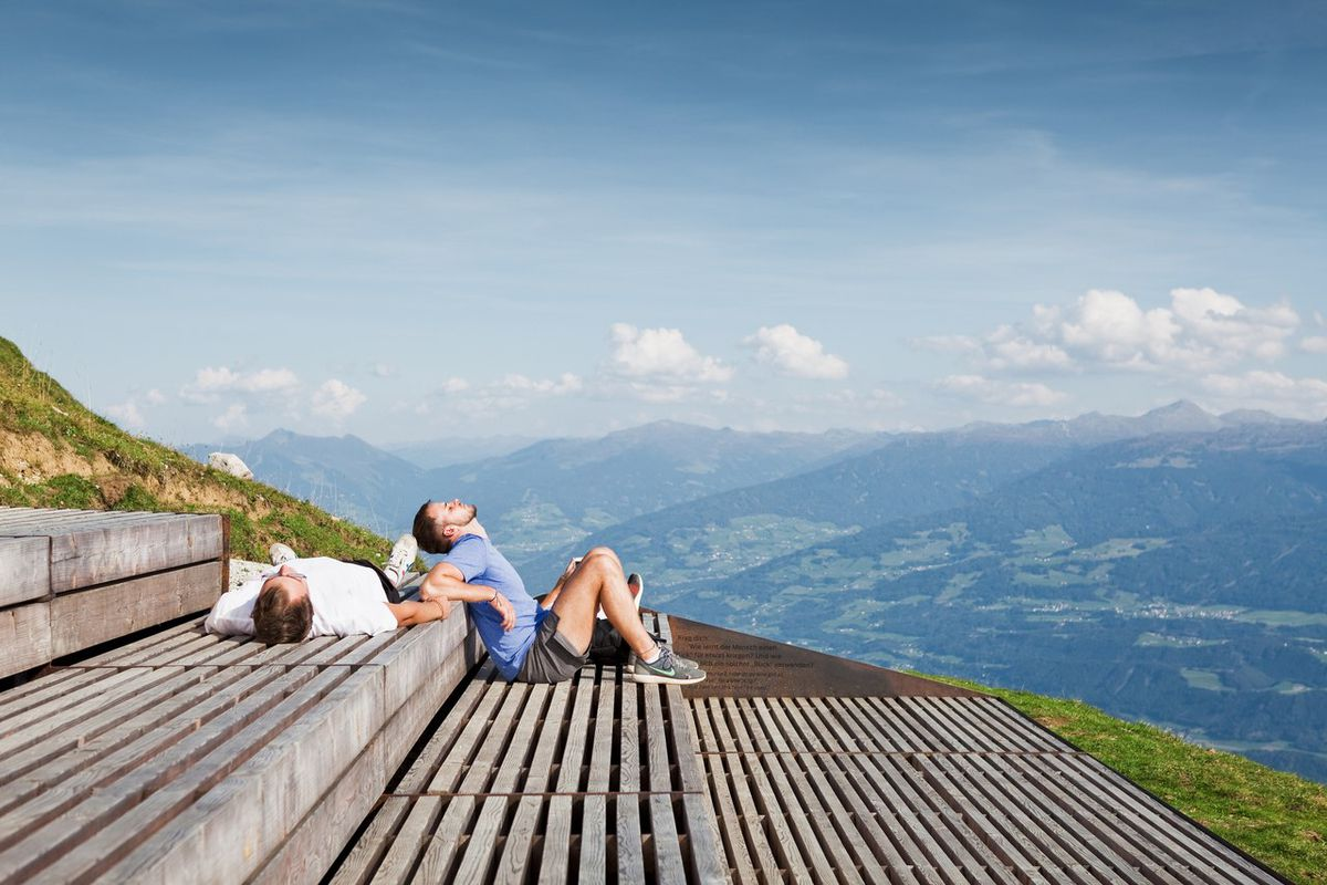 People sitting on wooden steps