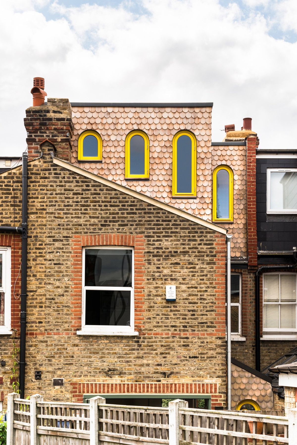 London family home renovation with scale-like shingles