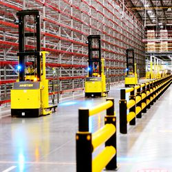 Workers move about inside the newly opened Amazon fulfillment center in West Jordan on Monday, Sept. 14, 2020.