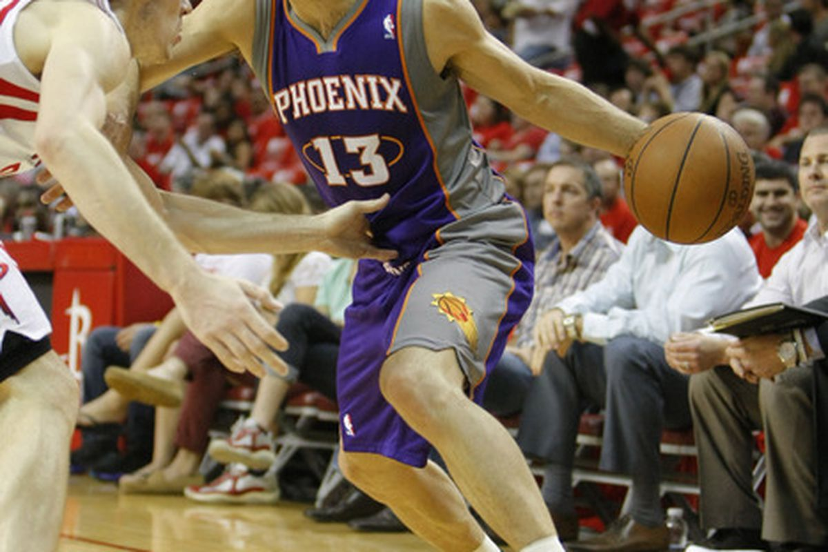 Apr 13, 2012; Houston, TX, USA; Phoenix Suns guard Steve Nash (13) drives to the basket against the Houston Rockets in the first quarter at the Toyota Center. Mandatory Credit: Brett Davis-US PRESSWIRE