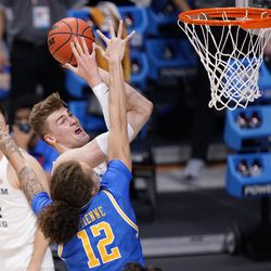 BYU forward Matt Haarms (3) shoots over UCLA forward Mac Etienne (12) during the first half of a first-round game in the NCAA college basketball tournament at Hinkle Fieldhouse in Indianapolis, Saturday, March 20, 2021.