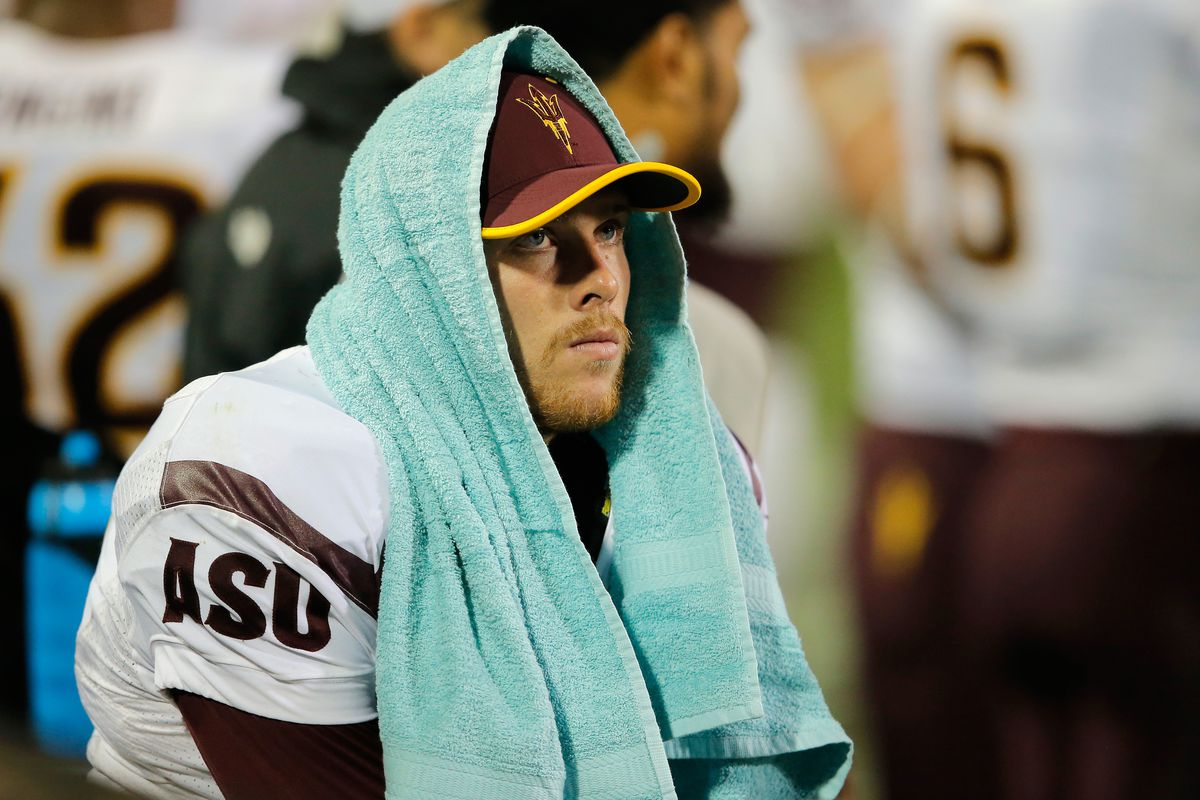 Taylor Kelly #10 looks on after leaving Saturday's game against CU