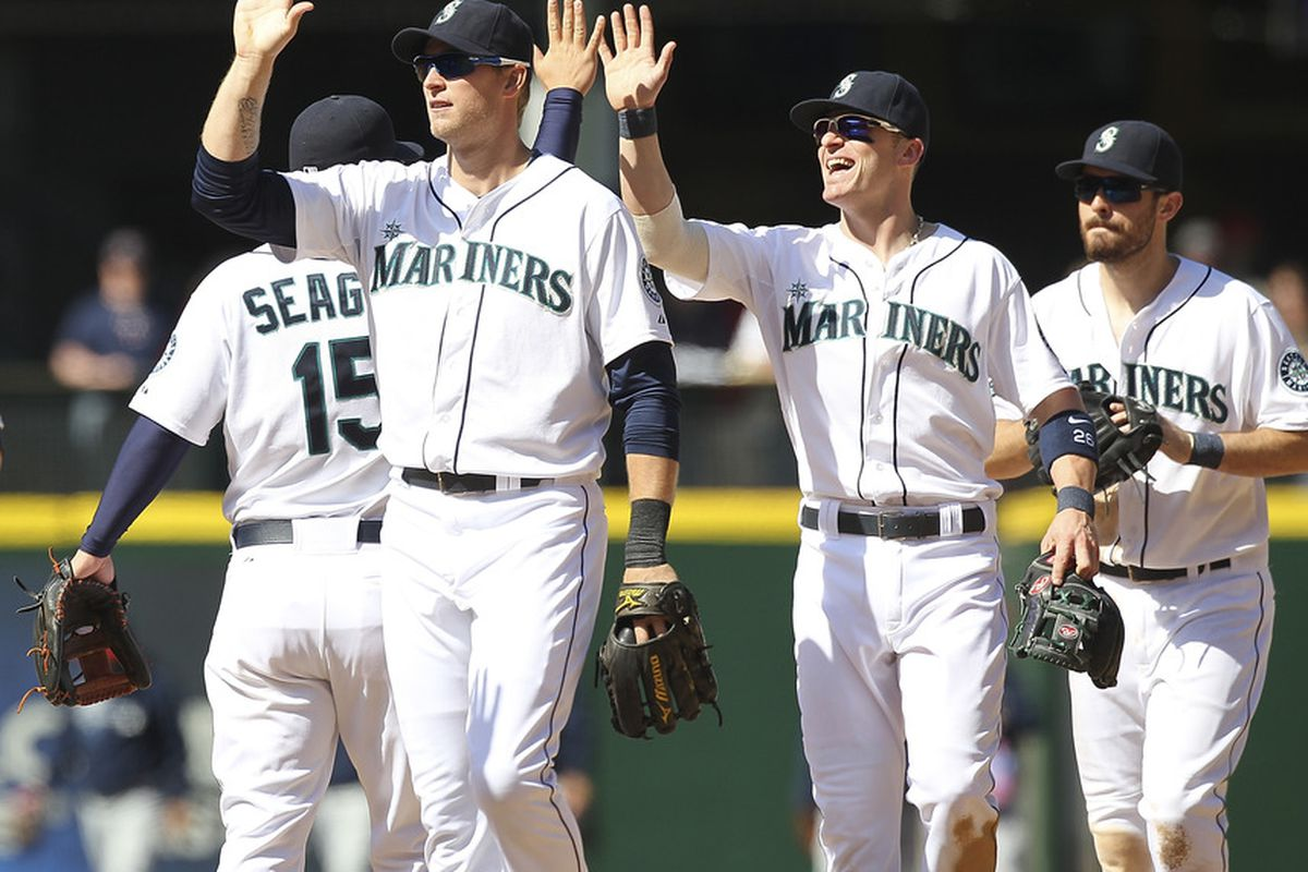 SEATTLE, WA - MAY 06:  Members of the Seattle Mariners celebrate after defeating the Minnesota Twins 5-2 at Safeco Field on May 6, 2012 in Seattle, Washington. (Photo by Otto Greule Jr/Getty Images)