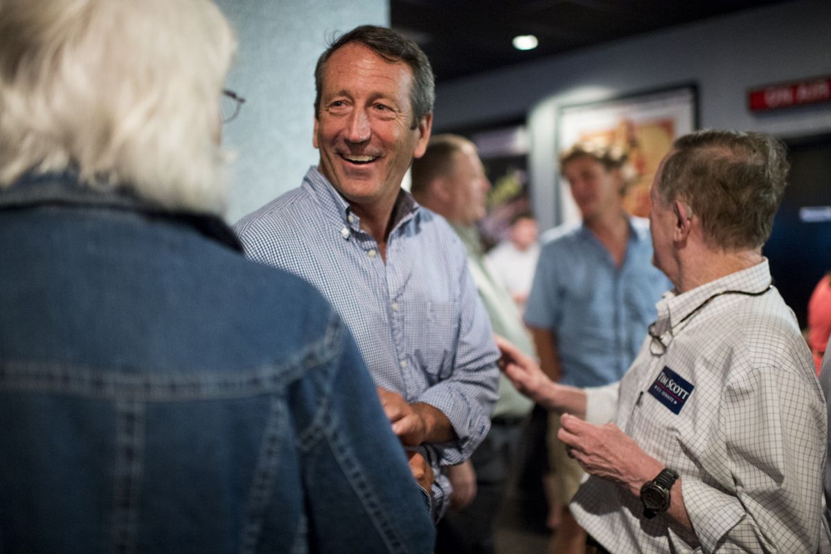 Mark Sanford speaks with fellow Republicans in the lobby of the Mount Pleasant Cinebarre theater following the Charleston County GOP debate watch party in Mount Pleasant, S.C. on Thursday, Aug. 6, 2015.