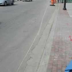 Lane marker that was just repainted a few days ago is barely visible -