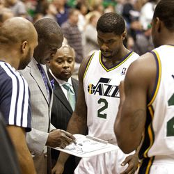 Jazz head coach Tyrone Corbin goes over plays before the first half of the NBA basketball game between the Utah Jazz and the Golden State Warriors at Energy Solutions Arena, Wednesday, Dec. 26, 2012.
