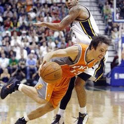 Utah Jazz guard Devin Harris (5) defends Phoenix Suns guard Steve Nash (13) as the Utah Jazz and the Phoenix Suns play Tuesday, April 24, 2012 in Energy Solutions arena.