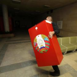Election commission official carries ballot box at a polling station on the day before elections in Minsk, Belarus, Saturday, Sept. 22, 2012.  Belarus will hold a parliamentary elections on Sunday, but most power will remain in the hands of authoritarian President Alexander Lukashenko.