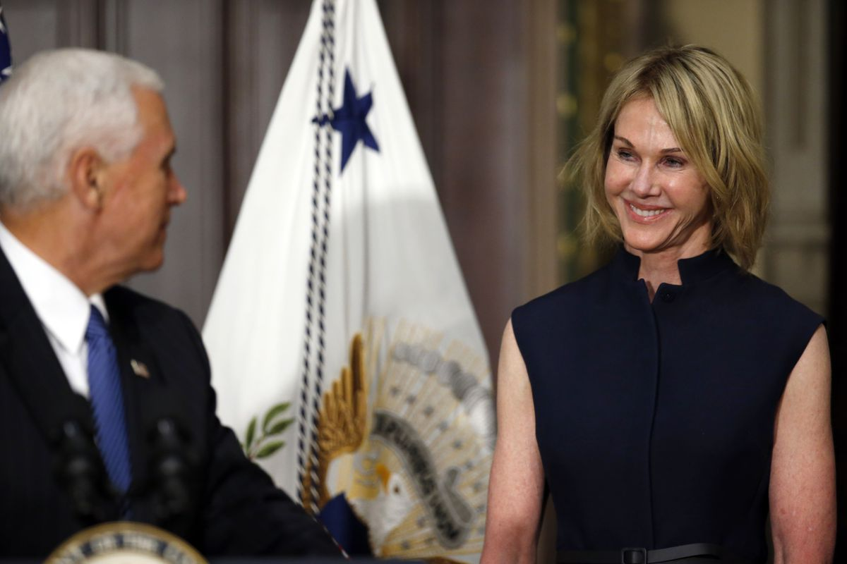 Vice President Mike Pence turns to speak to Kelly Knight Craft during her swearing-in ceremony to be U.S. Ambassador to Canada, in September 2017.