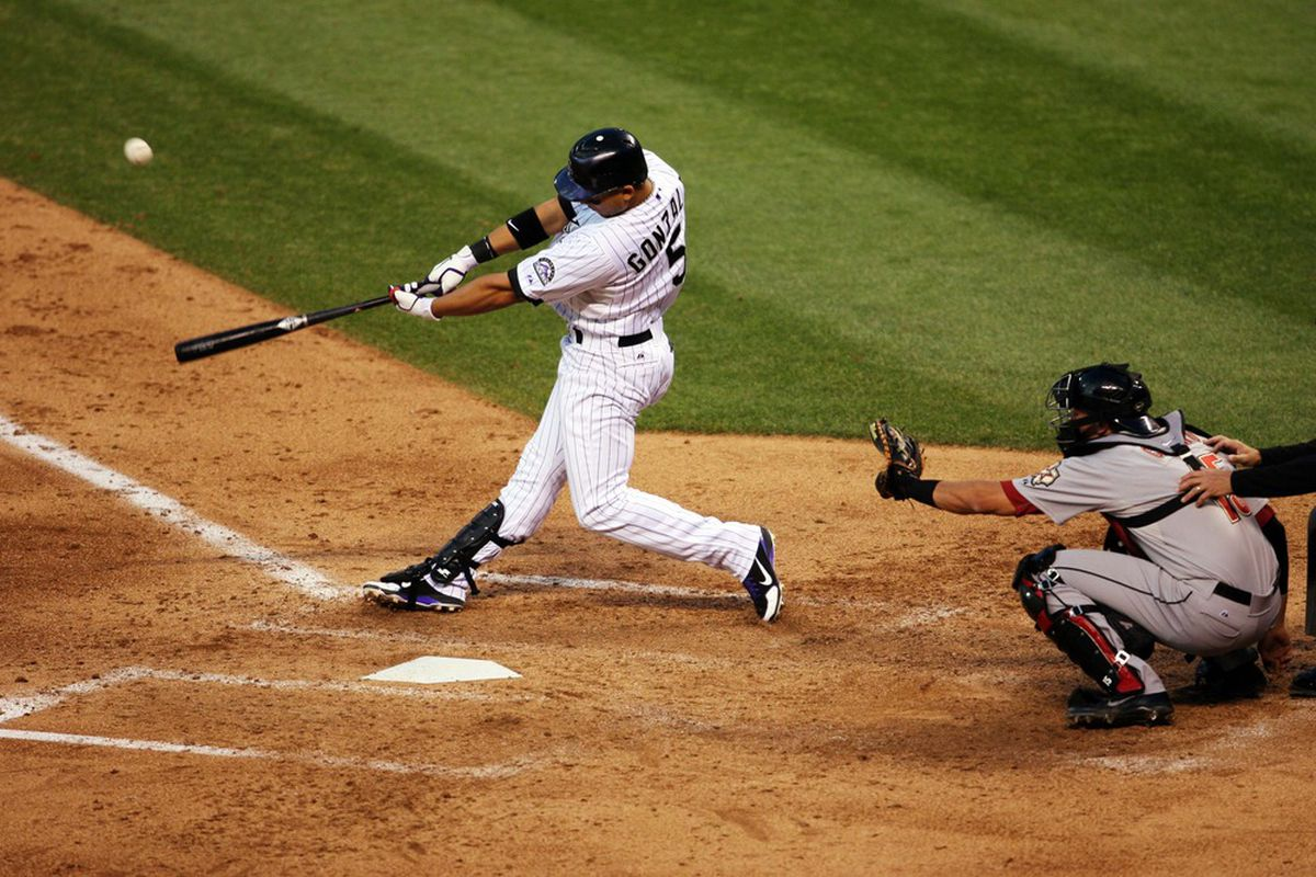 May 31, 2012; Denver, CO, USA; Colorado Rockies left fielder Carlos Gonzalez (5) hits a double during the fourth inning against the Houston Astros at Coors Field.  Mandatory Credit: Chris Humphreys-US PRESSWIRE