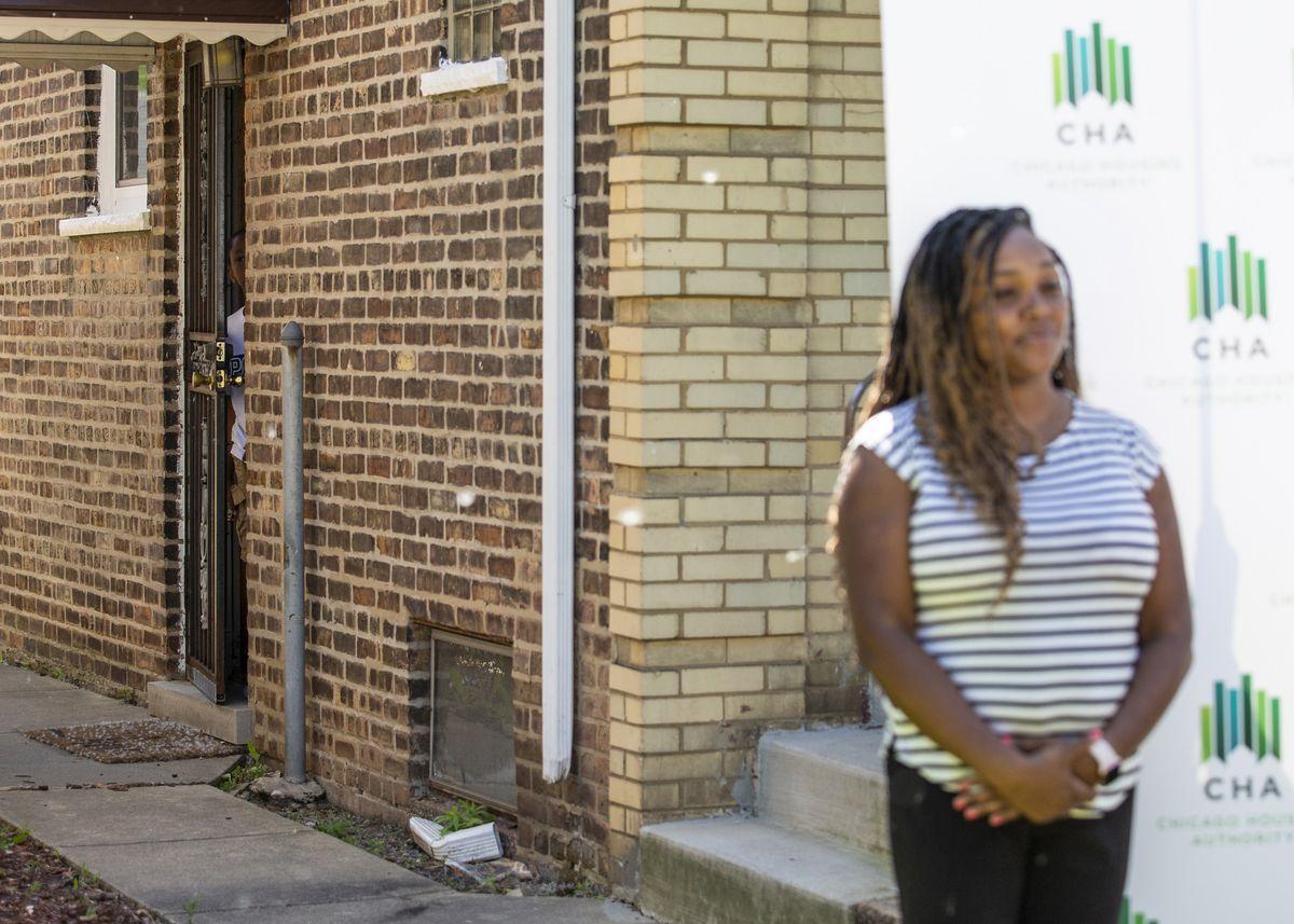 Zion Wilkins (peeking out of door) and his mother, Niesha Chism.