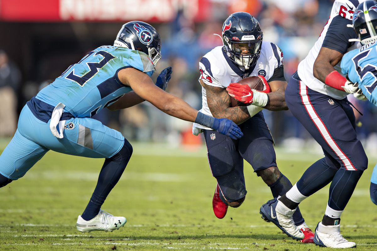 Carlos Hyde of the Houston Texans runs the ball during a game against the Tennessee Titans at Nissan Stadium on December 15, 2019 in Nashville, Tennessee.