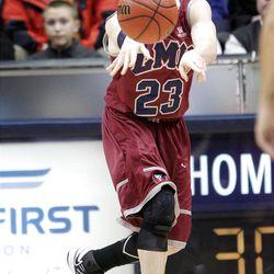 Loyola Marymount Lions guard Chase Flint (23) passes in Provo  Thursday, Jan. 3, 2013.