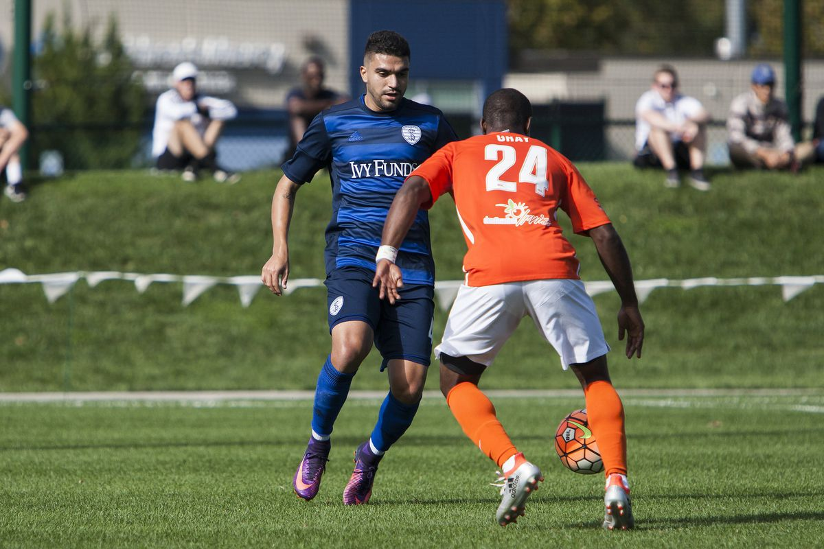 Gray (No. 24 in orange) in action for the Blues in 2016.