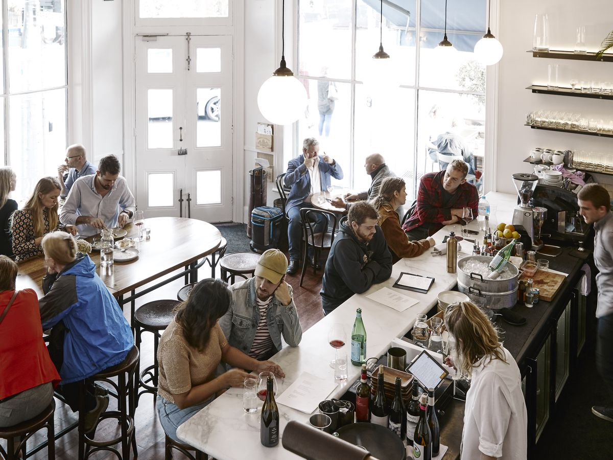 Diners and drinkers fill the dining room at Carlton Wine Room