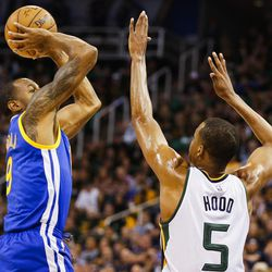 Golden State Warriors forward Andre Iguodala (9) shoots over Utah Jazz guard Rodney Hood (5) during Game 4 of the Western Conference Semifinal at Vivint Smart Home Arena in Salt Lake City on Monday, May 8, 2017.