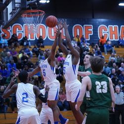 Proviso East's Keashon Fancher (15) and Aaron Skyes (5) both go up for a rebound against Lane, Wednesday 02-27-19. Worsom Robinson/For Sun-Times