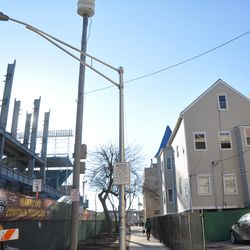 The new jumbotron posts are about the same height as the building on the right -