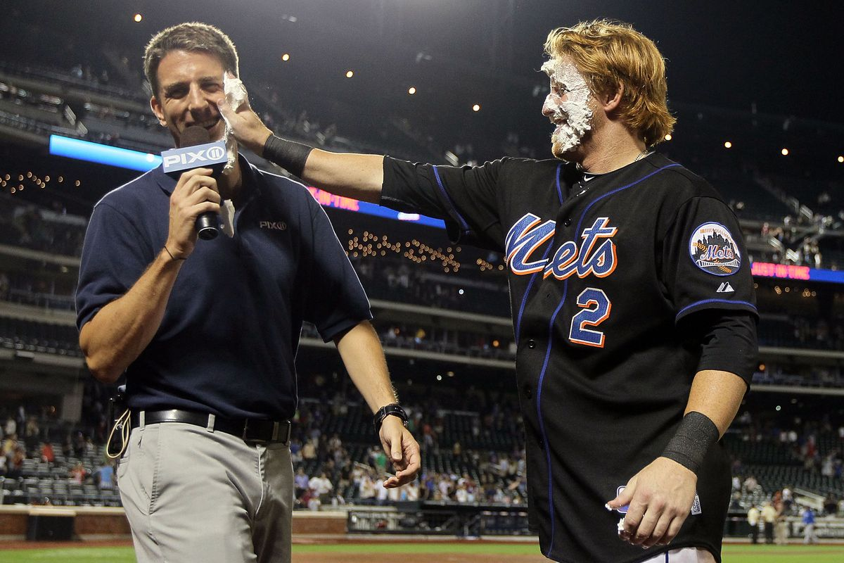 Kevin Burkhardt getting a pie in the face from former Met Justin Turner.