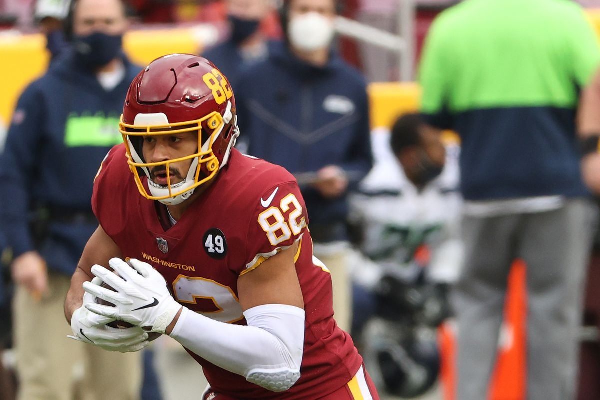 Tight end Logan Thomas #82 of the Washington Football Team rushes the ball against the Seattle Seahawks at FedExField on December 20, 2020 in Landover, Maryland.
