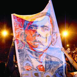 Obama supporters raise a banner in Grant Park after Obama was declared the next president of the U.S.