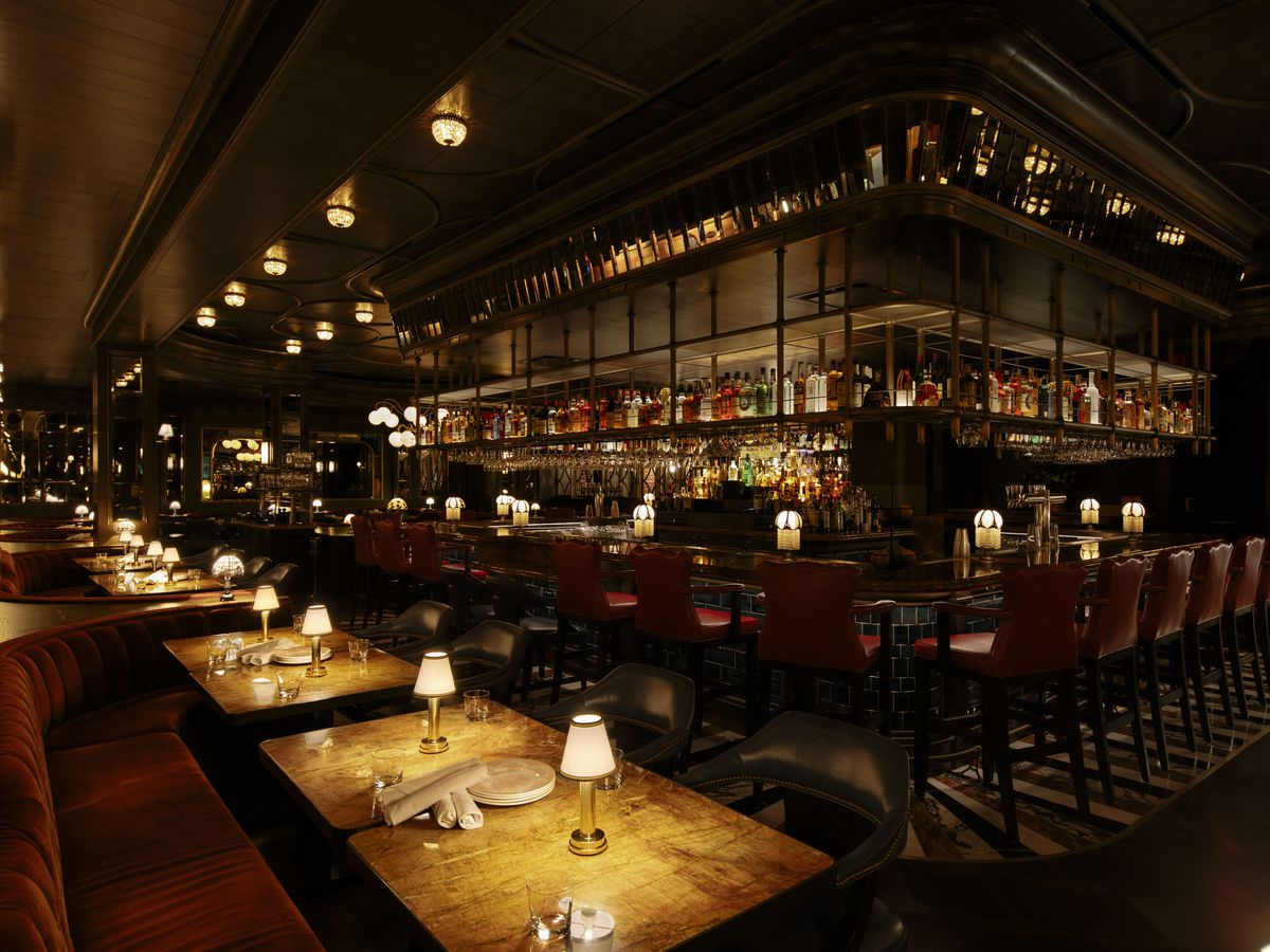 A dimly lit photo of a steakhouse