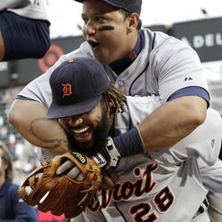 Detroit Tigers' Miguel Cabrera, top, hitches a short ride on Prince Fielder after the Tigers beat the Minnesota Twins 2-1 in a baseball game Sunday, Sept. 30, 2012 in Minneapolis.  Fielder had a two-run home run off Twins pitcher Jared Burton.