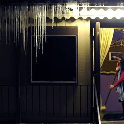 """Julie Day sweeps the front door entrance in preparation for the show """"The Best Christmas Pageant Ever"""" at the Valley Center Playhouse in Lindon on Thursday, Dec. 12, 2013. Owners Keith and Jody Renstrom are closing the playhouse on Dec. 21 after 38 years of community theater."""