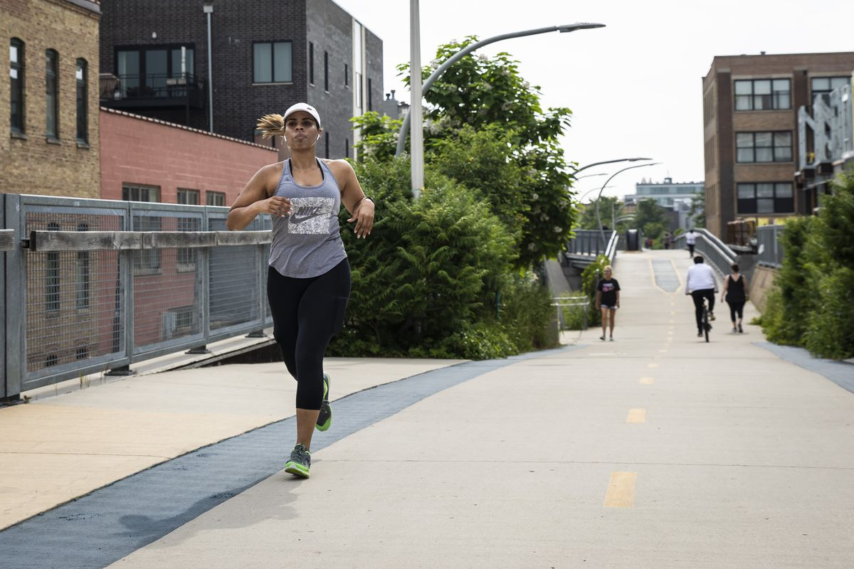 People exercise on The 606 trail near Western Avenue on the North Side on the first day the park reopened to the public after being closed amid fears of the coronavirus pandemic.