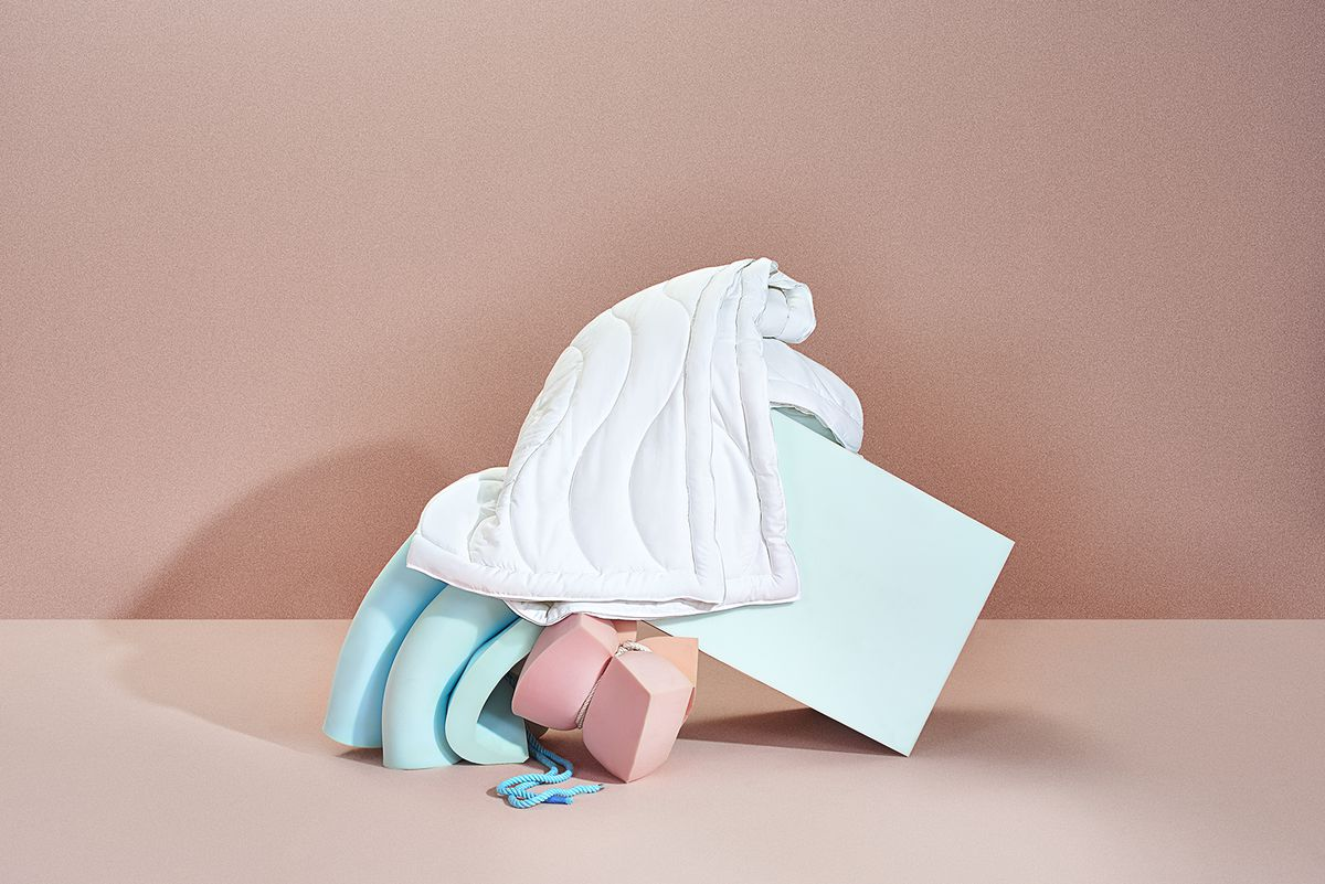 Comforter on mound of objects