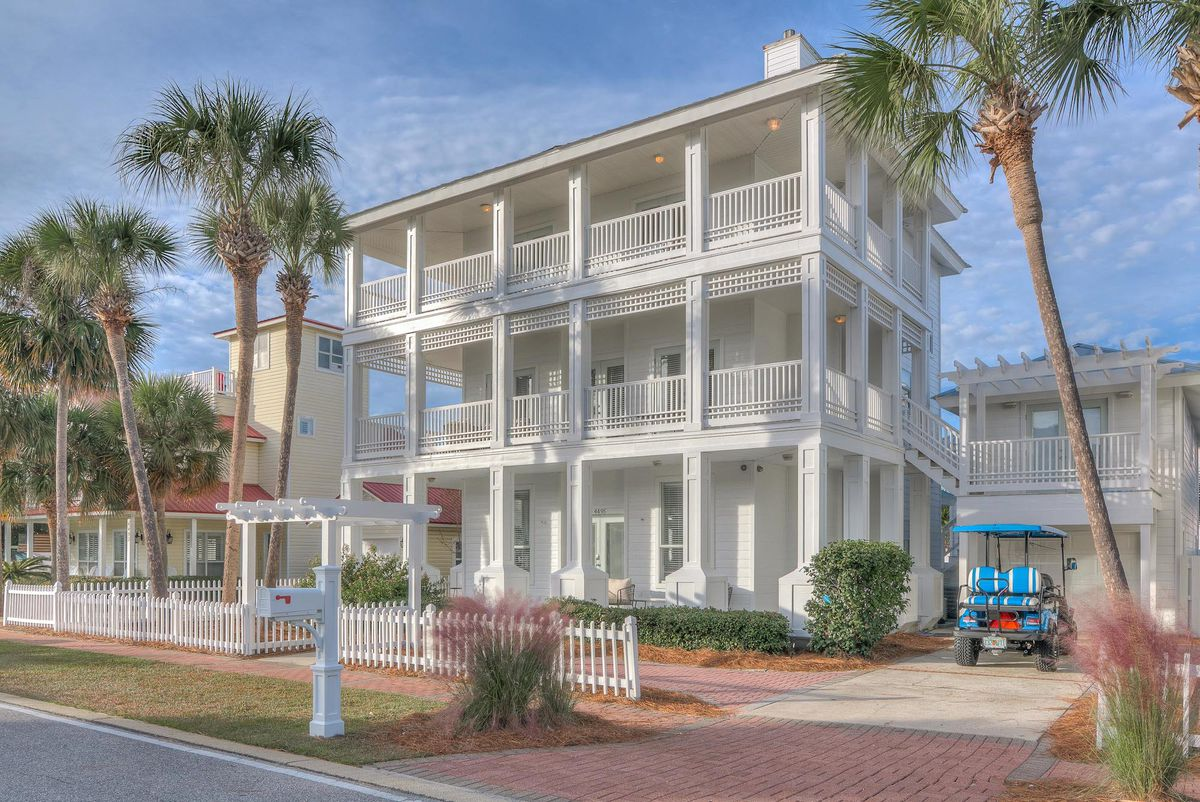 A three-story white beach house in Florida with wrap-around porches.