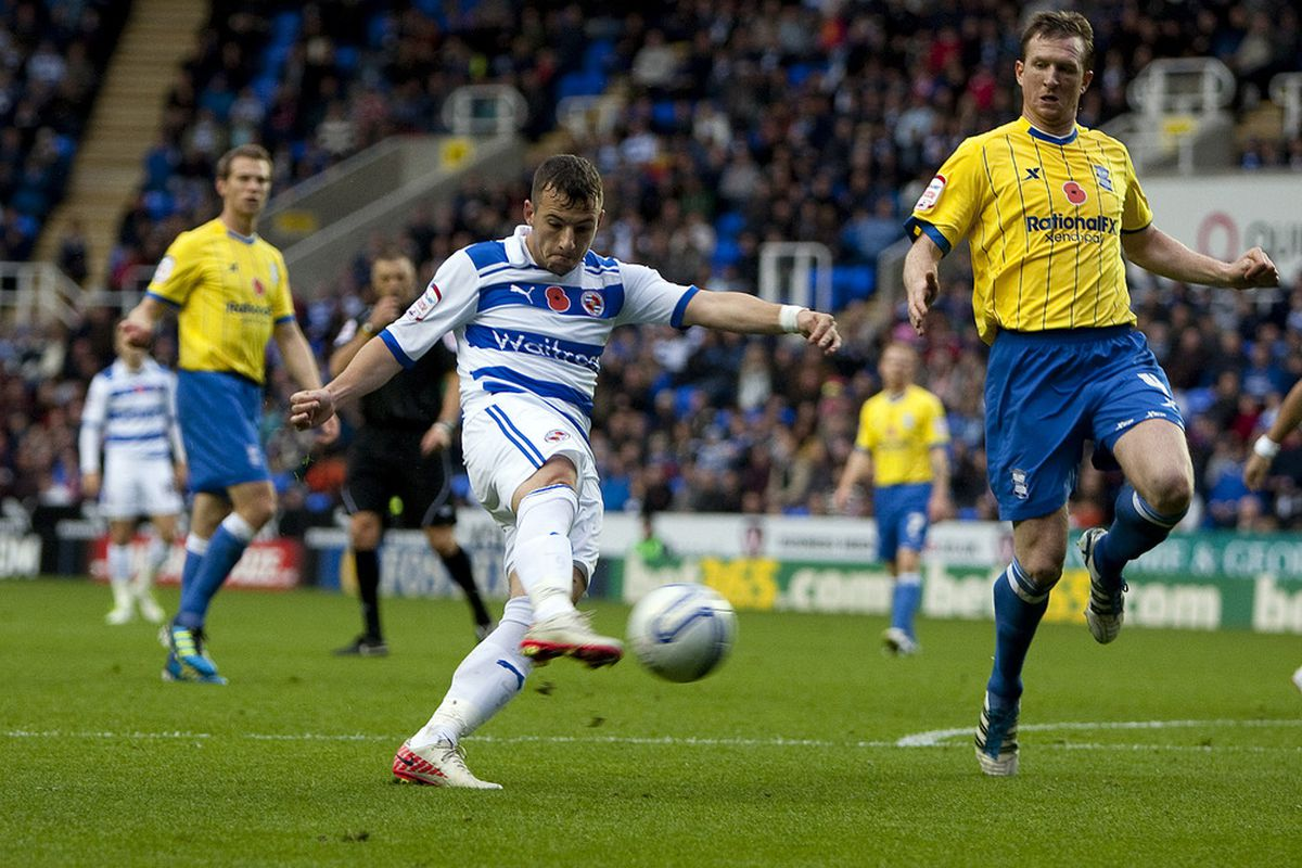 READING, ENGLAND - NOVEMBER 6: Adam Le Fondre of Reading shoots at goal during the npower Championship match between Reading and Birmingham City at the Madejski Stadium on November 6, 2011 in Reading, England.  (Photo by Ben Hoskins/Getty Images)