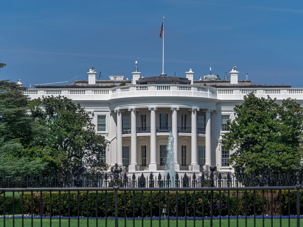 The exterior of the White House in Washington D.C. The building has columns flanking the entrance area.