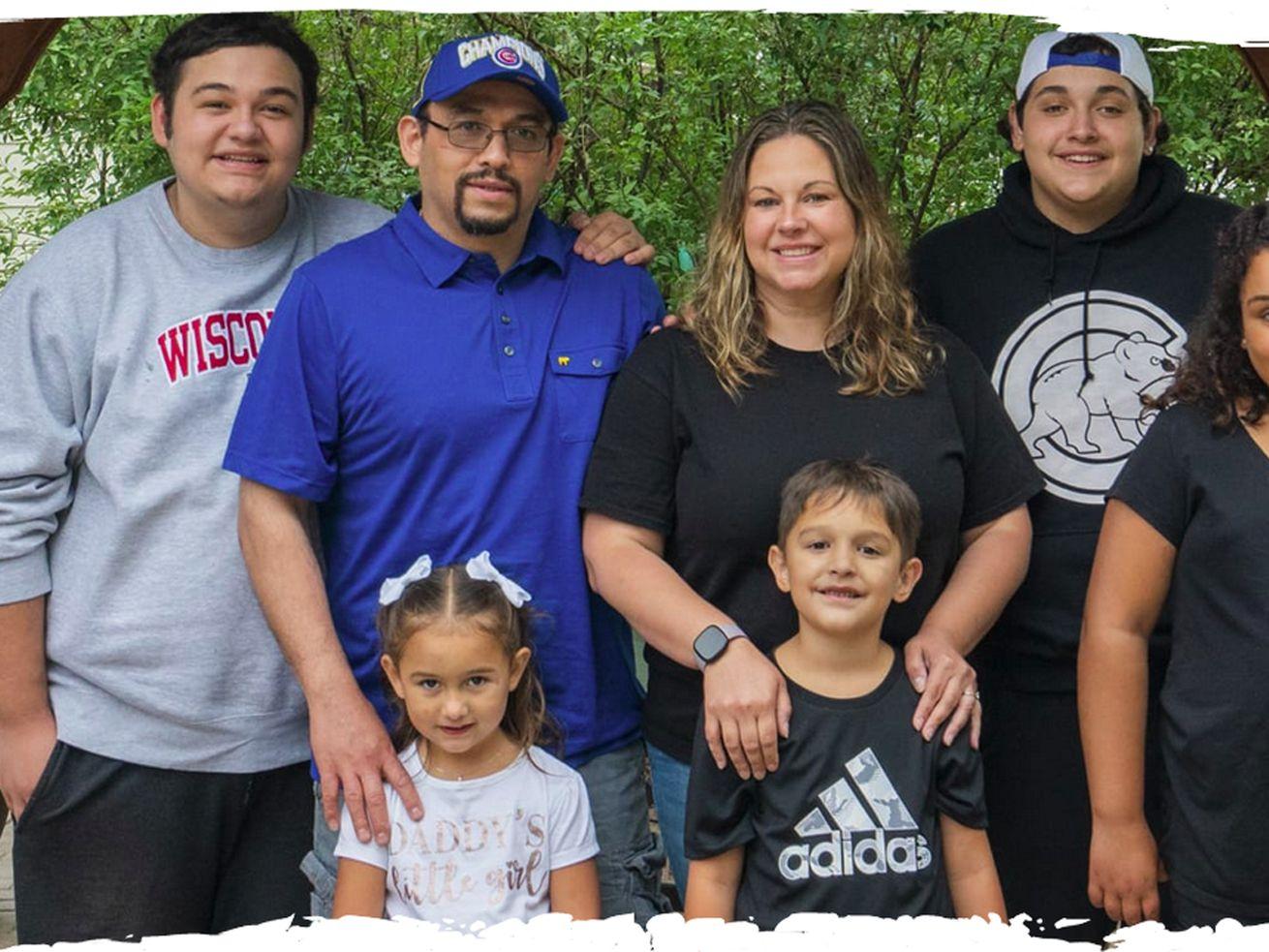 Isaiah, Aidan, Jocelyn, Evelyn and Alex Elizarraraz stand alongside their parents, Kristin Glauner and Cesar Mauricio Elizarraraz (in blue shirt) outside their home in Crystal Lake.