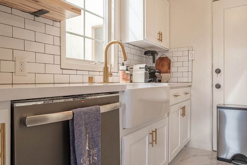 A white kitchen with a deep sink.
