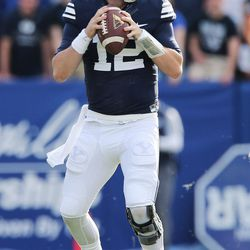 Brigham Young Cougars quarterback Tanner Mangum (12) throws against the Southern Utah Thunderbirds  in Provo on Saturday, Nov. 12, 2016.